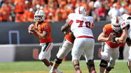Miami's Stephen Morris threw for ACC-record 566 yards against N.C. State on Saturday