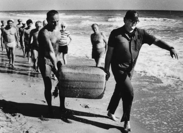 Lt. Tony Mazza, Sea Ranch Lakes Police (left) and Broward Sheriff's Office Marine Patrol Deputy Gerry Brown (right)BSO Marine Patrol removed bales of pot that had washed ashore in south Pompano and Lauderdale-By-The-Sea area in November 1985.