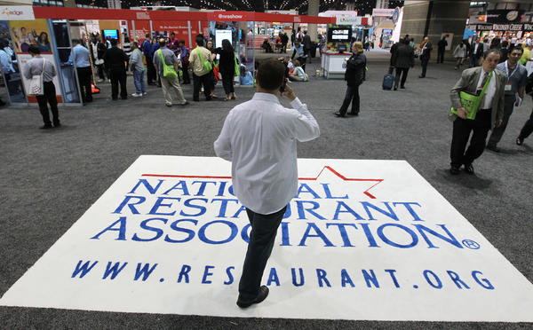 Attendees arrive at the National Restaurant Association show at McCormick Place in Chicago in May 2012.