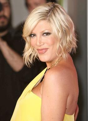 "Actress and Hollywood princess Tori Spelling, who starred in TV's ""Beverly Hills, 90210,"" is switching castles, listing her Westwood home for sale, and purchasing a new house in Encino."