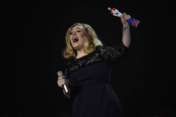 "Adele, shown at the BRIT Awards in February, says that decades from now she'll be ""telling people I was a Bond girl back in the day."""