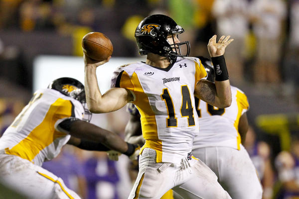 Towson Tigers quarterback Grant Enders (14) against the LSU Tigers during the fourth quarter of a game at Tiger Stadium. LSU defeated Towson 38-22.