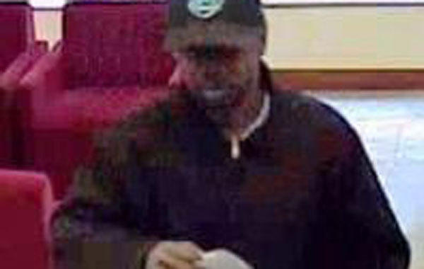 Surveillance photo of a man wanted in connection with a bank robbery today in the Loop.