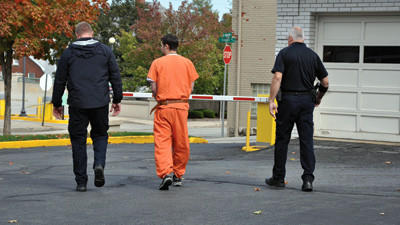 Cody Schartiger is escorted back to Somerset County Jail after hearing Monday.