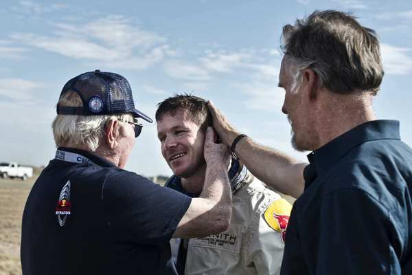 United States Air Force Col. (Ret.) Joe Kittinger, left, welcomes Baumgartner during the second manned test flight for Red Bull Stratos in Roswell, N.M.