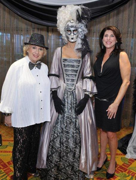 "Marleen Forkas, left, Marie Antoinette impersonator and Robin Trompeter at Habitat for Humanity of South Palm Beach's ""Black & White Masquerade Gala,"" which took place on Sept. 15 at the Marriott at Boca Center."