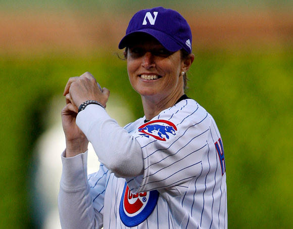 Kelly Amonte Hiller throwing out ceremonial first pitch at Wrigley Field in honor of her team's 7th NCAA title in 8 years.