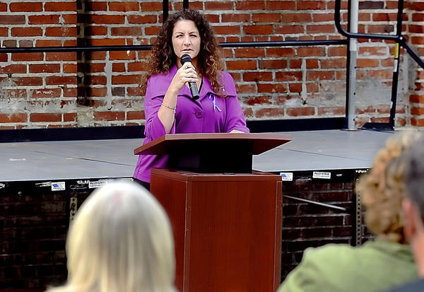 Sherry Donovan, chairwoman of the board of directors of Citizens Assisting and Sheltering the Abused, speaks Monday at a kickoff for National Domestic Violence Awareness Month at University Plaza in Hagerstown.