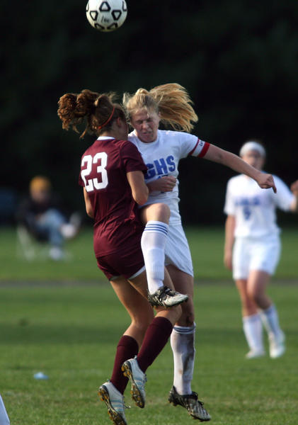 South Windsor's Rebecca Russo, left and Glastonbury's Kate Smith collide in the 1st half of play. Glastonbury won, 3-0.