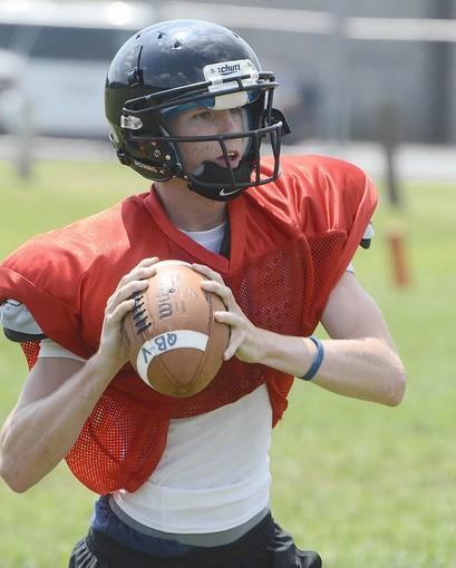 Westminster High School senior Deryk Kern, shown during a practice last month, leads the county in virtually every quarterback statistic, and earlier this month tied a state record with seven touchdown passes in a single game — a 49-14 win over Linganore — while playing only three quarters.