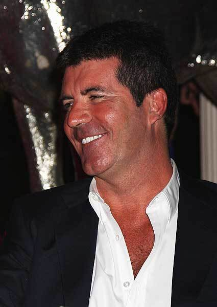 "Former American Idol nice-guy <a class=""taxInlineTagLink"" id=""PECLB001160"" title=""Simon Cowell"" href=""/topic/entertainment/television/simon-cowell-PECLB001160.topic"">Simon Cowell</a> celebrates his 52nd birthday today. (Photo by Chris Jackson/Getty Images)"