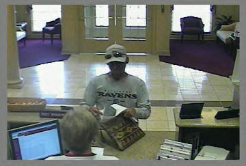 This surveillance photograph from Frederick County Bank in Walkersville, Md., shows the suspect in a Monday afternoon robbery.