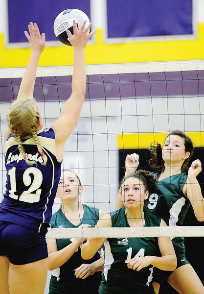 Smithsburg's Haley Caudell (12) goes up for the block as South Hagerstown's Alisha Adkins (10), Hayley Freeman (14) and Elena Young (9) can only watch Monday night.