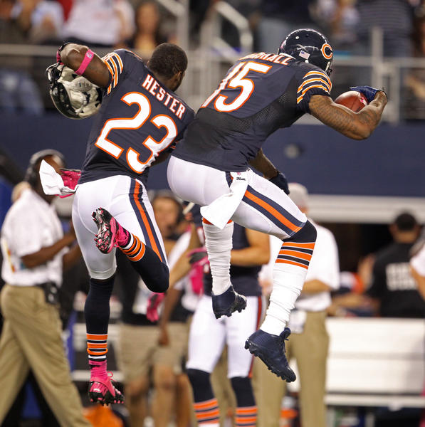 Devin Hester celebrates with Brandon Marshall after Marshall's touchdown against the Cowboys during the fourth quarter.