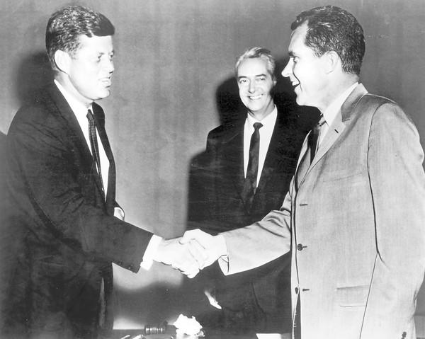 John F. Kennedy (left) and Richard Nixon (right), with moderator Howard K. Smith looking on, meet before their presidential debate in 1960.