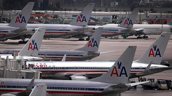 American Airlines planes sit on the tarmac at the Miami International Airport.