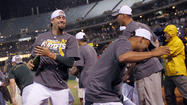 Oakland win ties A's with Orioles in AL wild-card race