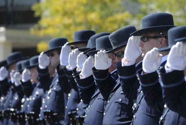 Harford County sheriff's deputies salute as Cpl. Charles B. Licato's coffin passes by before funeral services last month. Licato was one of four officers to die in a two-week span.