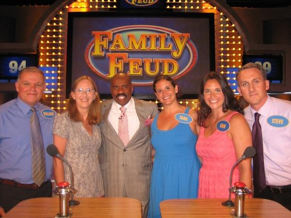 "The Charest family (from left, Roland, Janet, Tara, Erin, Steve) on ""Family Feud"" with host Steve Harvey, center."
