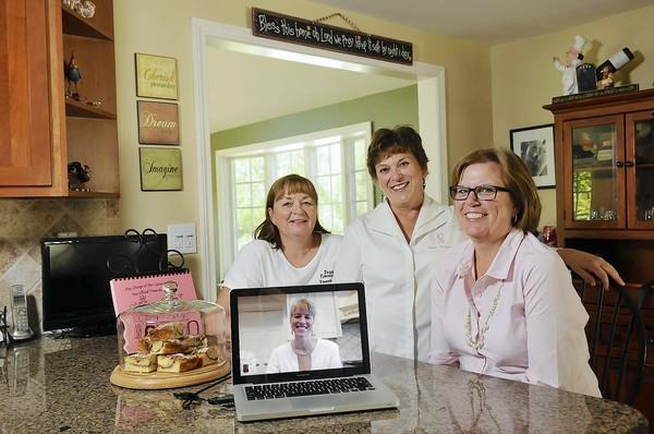 Members of the Wethersfield-based Team Towanda Foundation Debbie Garten, left, Judith Melchreit and Alison Caxide are chatting via Skype with Monica Smith in Maryland about their ongoing efforts to raise funds and awareness to fight breast cancer. With the help of other members of the group, the foundation has created two cookbooks and raised more than $250,000 for breast cancer prevention and treatment.