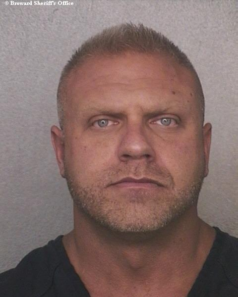 Broward Sheriff's Deputy Mathew Eisenberg was booked into the Broward County Main Jail Tuesday on a felony charge of official misconduct and two misdemeanor charges of battery and falsifying records. Investigators said he hit a homeless man who was handcuffed in the back of a police vehicle in November 2011.