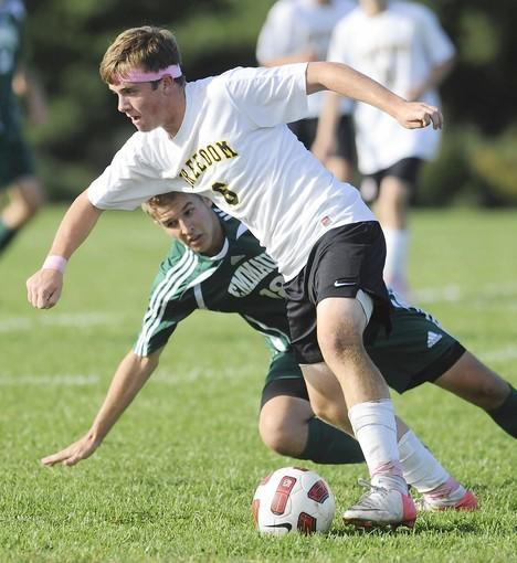 Emmaus' Luke Sebastian (back) defends Freedom's Jackson Zappas.