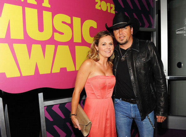 Musician Jason Aldean (R) and Jessica Aldean arrive at the 2012 CMT Music awards at the Bridgestone Arena on June 6, 2012 in Nashville, Tennessee.