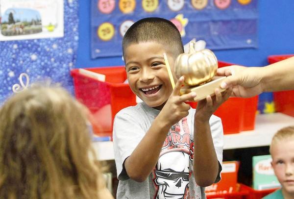 Daniel Villalpando is all smiles after getting the golden pumpkin award for winning the Pumkin Chunkin contest in Nancy Jang's class at Woodland Elementary.