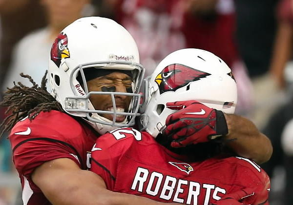 Wide receiver Larry Fitzgerald #11 of the Arizona Cardinals celebrates with wide receiver Andre Roberts #12 after Roberts scored a 15 yard touchdown reception against the Miami Dolphins during the fourth quarter of the NFL game at the University of Phoenix Stadium on September 30, 2012 in Glendale, Arizona. The Cardinals defeated the Dolphins 24-21 in overtime.