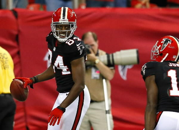 Roddy White #84 of the Atlanta Falcons reacts after his touchdown against the Carolina Panthers with Julio Jones #11 at Georgia Dome on September 30, 2012 in Atlanta, Georgia.