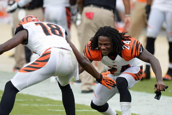 Cincinnati Bengals cornerback Adam Jones (24) and wide receiver A.J. Green (18) celebrate after Green caught a touchdown pass during the fourth quarter against the Jacksonville Jaguars at Everbank Field.