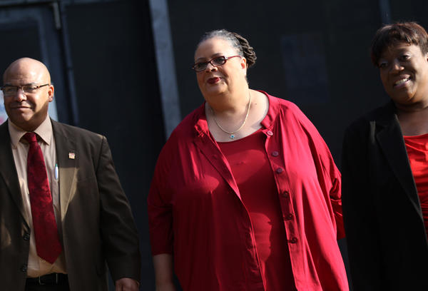 Chicago Teachers Union President Karen Lewis leaves Walter H. Dyett High School in Chicago after casting a ballot for the tentative contract agreement.