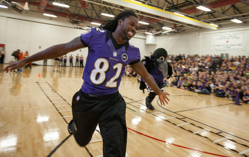 Baltimore Ravens wide receiver Torrey Smith runs through the gym at Linton Springs Elementary during a visit to promote the NFL Play 60 challenge. The campaign is designed to combat childhood obesity by encouraging kids to be active at least 60 minutes a day.