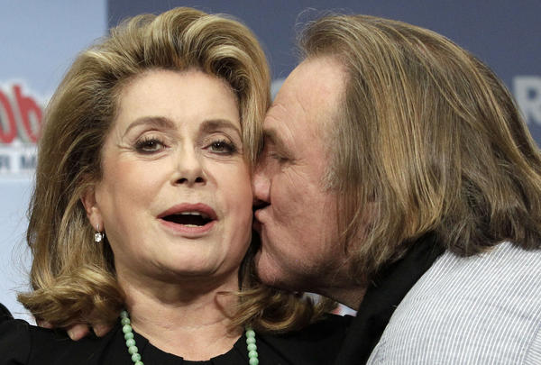 "Actors Gerard Depardieu and Catherine Deneuve (L) pose to promote the movie ""Asterix und Obelix - Im Auftrag ihrer Majestaet"" in Berlin."