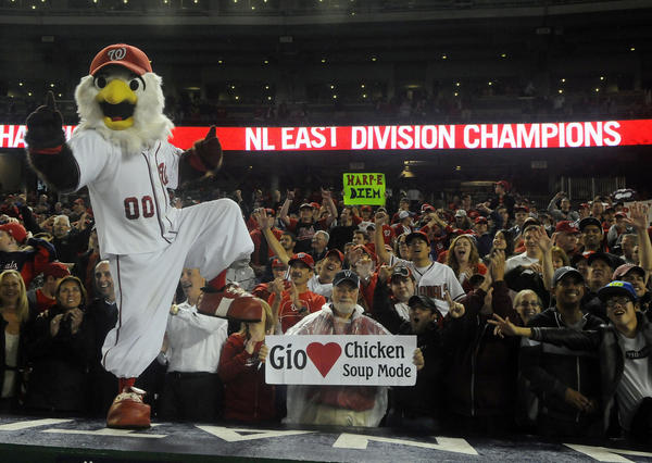 Washington Nationals mascot Screech and fans celebrate after clinching the National League east title at Nationals Park.