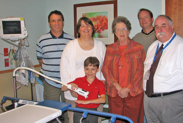 Relatives of Larry Nix, in whose name a nearly $10,000 donation was made to the emergency department of City Hospital in Martinsburg, W.Va., gather recently at the hospital. Pictured, from left, are Jan Derezinski; Linda Derezinski; Max Derezinski; Anne Nix; Mark Nix; and Chuck Hilty, emergency department manager.