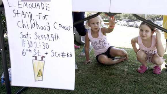 Six-year old Aleyna Doche, of Burbank, left, and her best friend Phoebe Wise, also 6, take a little break at her lemonade stand at 6th St. and Scott Rd. in Burbank on Saturday, Sept. 29, 2012.