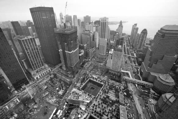 "The view from the unfinished Freedom Tower that rises above the ""Reflecting Absence"" memorial."