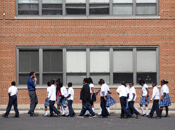 Students return to class after recess at St. Margaret of Scotland school Tuesday, Oct. 2, 2012, in Chicago.