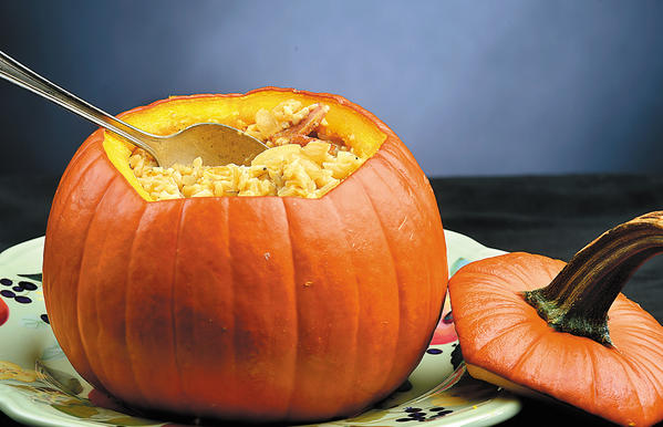 Using a medium-sized pumpkin as a serving bowl is an eye-catching way to serve pumpkin as a savory dish for dinner or a holiday meal.