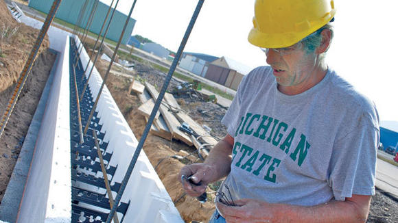 Bruce Wicke, of Johnson Diversified Services, readies plastic foam forms for a concrete foundation of a new equipment building at Gaylord Regional Airport Tuesday.