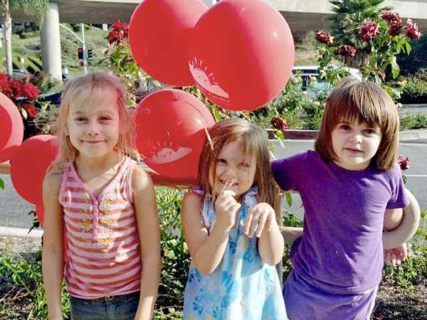 Preschoolers, from left, Ella and Lily Weber and Ella Comisar wait in line at La Cañada's North Shore Burgers, which partnered with the Community Center of La Cañada Flintridge for a fundraiser with 10% of the restaurants proceeds to be donated to the community center.