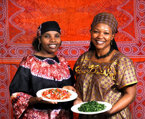 Maggie Muthoka of Easton, left, and Sherrie Moki of Easton, both originally from Kenya, show foods they will serve at Kenyan Dinner at First Presbyterian Church of Easton on October 6. Maggie is holding a kachumbari at left and Sherrie is showing sukuman wiki at right.