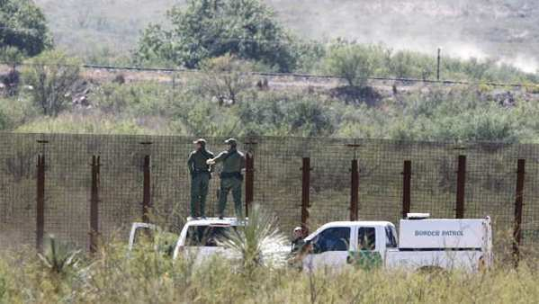 U.S. Border Patrol agents inspect the scene of the fatal shooting of a fellow agent, Nicholas Ivie.