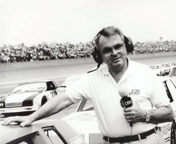 Sports, journalist Chris Economaki is shown at Daytona International Speedway in Daytona Beach, Fla. Economaki, regarded as the authoritative voice in motorsports for decades, died Friday, Sept. 28, 2012. He was 91.