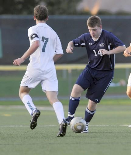 Liberty's Ian Larimer goes past Emmaus' Patrick Groh (7) in their boys soccer game at Emmaus High School on Monday September 26, 2011.