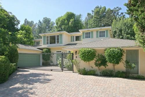 """John Kobylt, one-half of KFI-AM radio's  """"John and Ken Show"""" team, has listed his Beverly Hills home for sale at $2,695,000. The six-bedroom house was built in 2002. Kobylt, who anchors his popular talk show with Ken Chiampou, often plays the role of ranting hothead to Chiampou's straight man."""