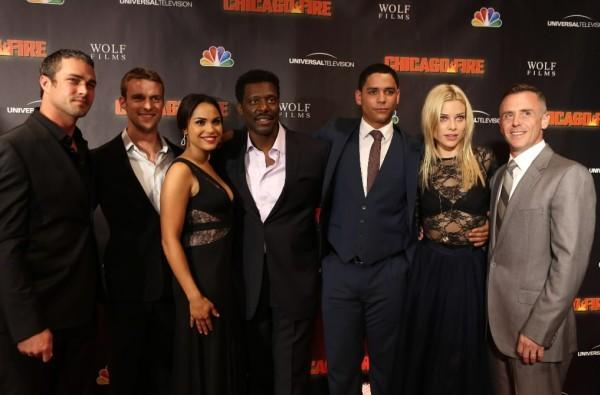 "The cast of NBC's ""Chicago Fire"" -- including Taylor Kinney (left) and Jesse Spencer (second to left) -- at the show's premiere at the Chicago History Museum October 2, 2012."