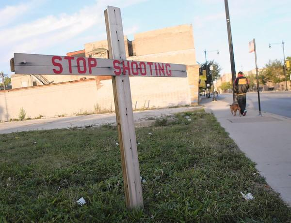 A cross at 79th Street and Loomis Boulevard serves as a reminder of the violence that has plagued the area this year. Police say a territorial dispute between factions of the Gangster Disciples is partly responsible for the increase in shootings.