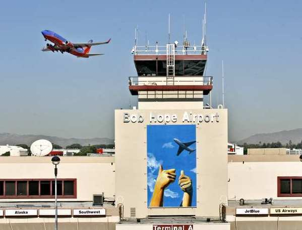 An airplane takes off at the Bob Hope Airport, where new art created by a student is being displayed at the airport's main entryway. The artwork was created by former Crescenta Valley student Iris Kim.